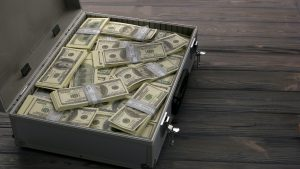 Briefcase with dollars.